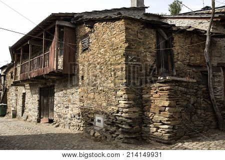 Rio de Onor is a village in northern Portugal with traditional houses on two levels being the upper level for the family and the lower level for animals cereals and other products of the land. Translation: Baixa da Costa Street