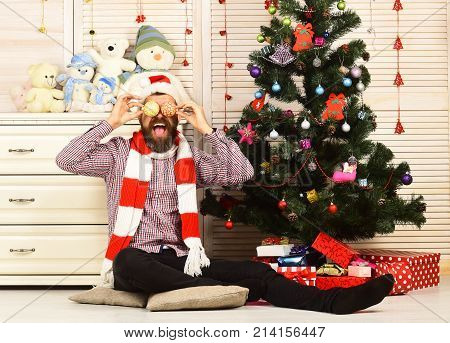 Festivals And Decor Concept. Man With Beard Holds Christmas Balls