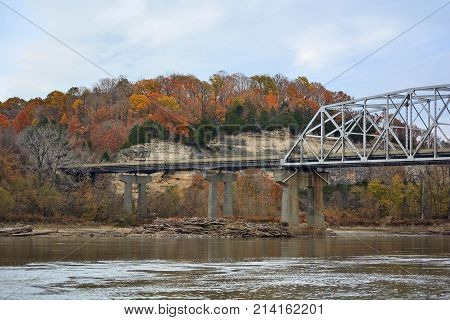 Highway Truss Bridge Over a River with Bluffs and Colorful Fall Autumn Leaves