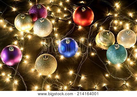 Christmas Decorations with Fairy Lights on Black Background