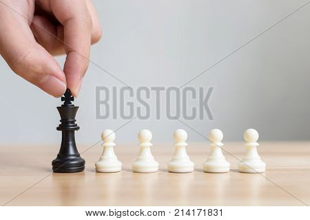 Different pawn chess board game Leadership business Unique Think different Individual and standing out from the crowd concept