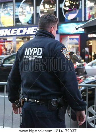 NEW YORK - NOVEMBER 16, 2017: NYPD strategic response group officer providing security on Times Square in Manhattan, New York