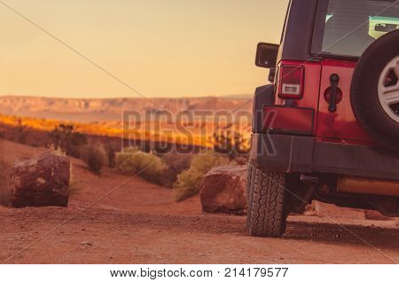 Driving Off Road Concept. Sport Utility Vehicle on the Sandy Arizona Desert Road.