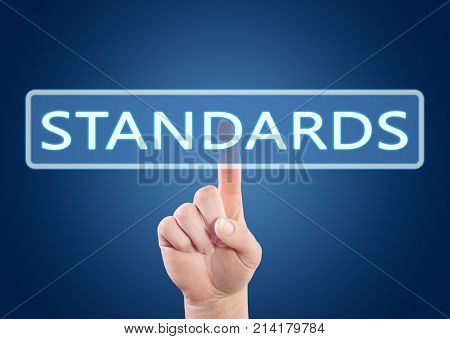 Hand pressing Standards button on interface with blue background.