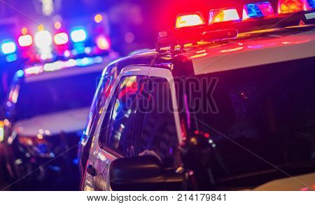 Night Time Police Violent Crime Intervention. Police Vehicles with Flashing Lights. poster