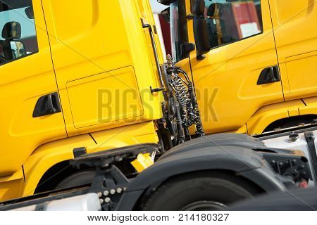 Semi Trucks Service Concept. Yellow Semi Tractor Closeup Photo.