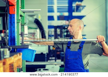one worker in factory working in stockroom