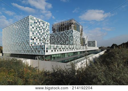 The Hague Netherlands - November 3 2017: The new 2016 opened International Criminal Court building with moat located between dunes in The Hague.