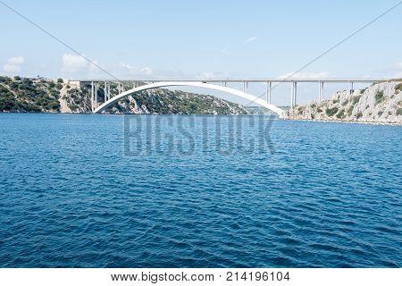 Sibenik bridge and the channel of river Krka froam a boat