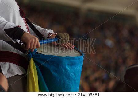 Ukrainian fan beats an Irish fan's bass drum, outside Parc Olympique Lyonnais
