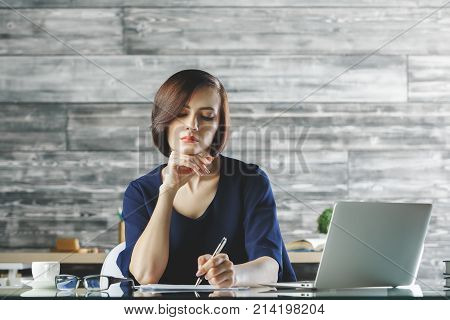 Gorgeous Business Woman Working On Project