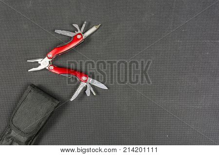 Red Folding Multifunctional Tool For Anglers.