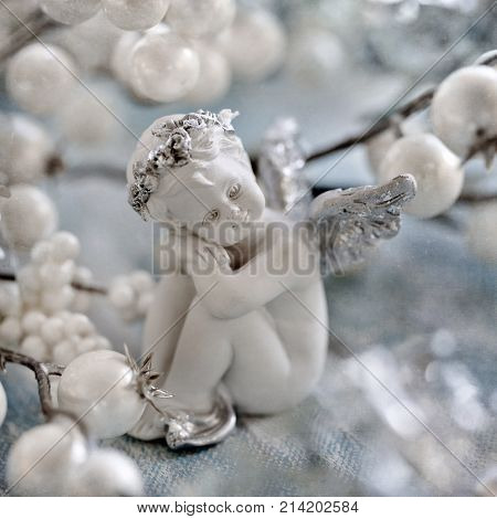 Angel toy on a Christmas background .Christmas card. Christmas decoration.
