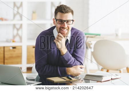 Attractive Smiling Businessman Working On Project