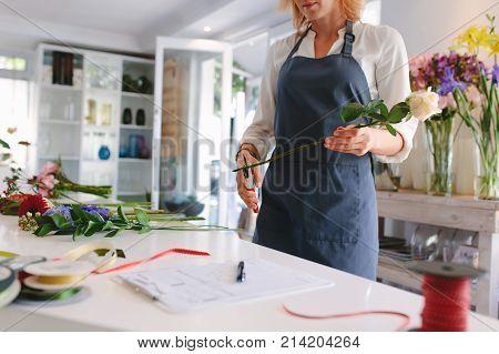 Skillful Woman Making Bouquet In Workshop