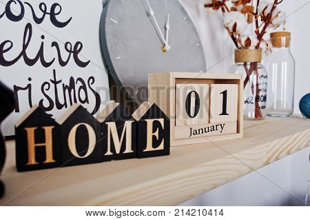 1 January Wooden Calendar With Home Sign. Happy Winter Holidays Concept.