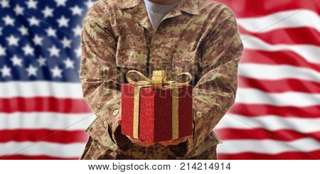 Christmas In The Army. Christmas Ball And Gift Box On An American Military Uniform