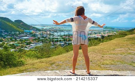 The back view of girl at Sint Maarten island, Caribbean sea