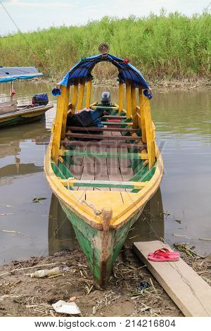 Wooden Color Canoe In River Port