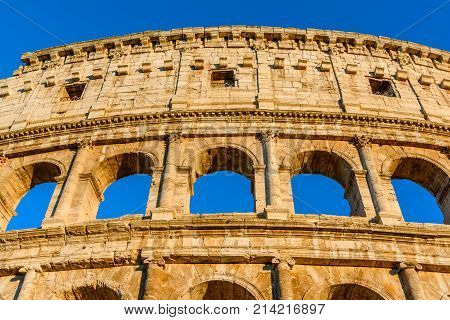 Night view of the Colosseum, an elliptical amphitheatre in the centre of Rome, Italy.Built of concrete and stone, it was the largest amphitheatre of the Roman Empire.It is the largest amphitheatre in the world