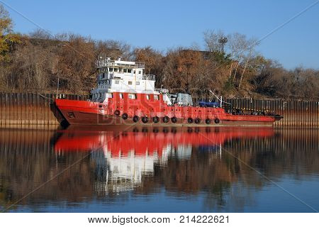 Old river tugboat docked in the backwater