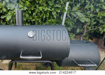 A black barbecue ready for grilling a slow cook pulled pork and ribs