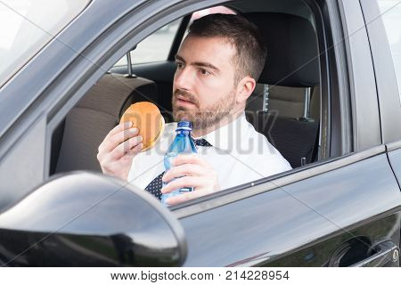 Man Having Lunch Seated In His A Car