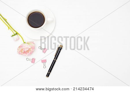 Workplace girl with a cup of coffee. Stock image