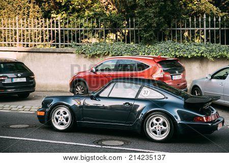 Prague, Czech Republic - September 23, 2017: Side View Of Porsche 964 Turbo Of Midnight Blue Metallic Car Moving In Street.