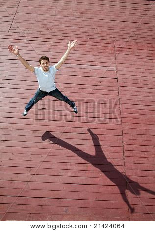 The Young Man Jumps With Joy