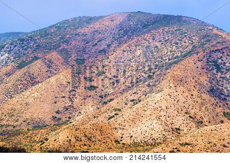 Barren mountains with chaparral shrubs taken at the Mojave Desert in Cajon, CA