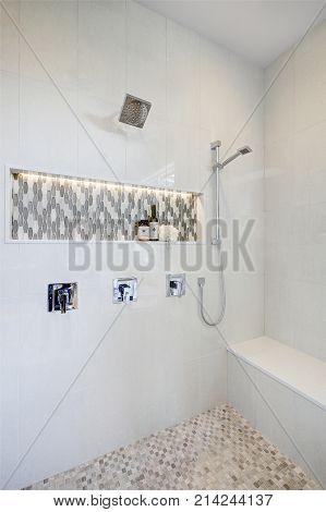 Stunning Walk-in Shower With White Tile Surround.