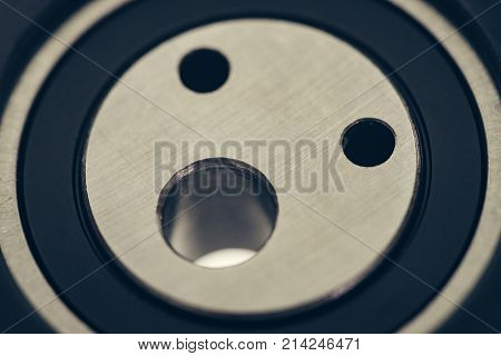 Tensioner pulley close-up. Macro photo. Auto spare parts. Background image.