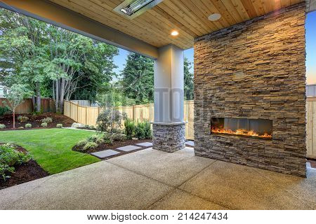 Outside Patio Boasts Gorgeous Stone Fireplace