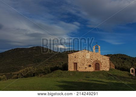 Ermita of Sant Elies. The colors of Autumn appear on the mountain, corollarizing it