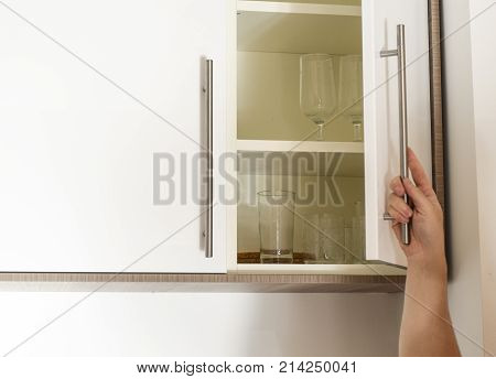 Hand On Handle Opening Cabinet