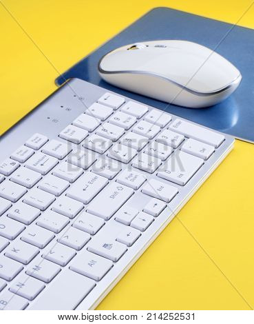 Close-up of white Computer input devices on Yellow