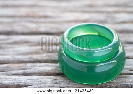 Jade ring on wooden Concept of love.