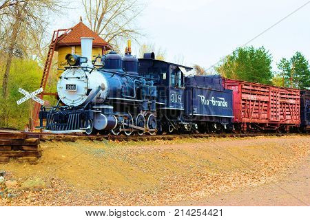November 6, 2017 in Golden, CO:  Vintage locomotive and rail cars on display at the Colorado Railroad Museum in Golden, CO where people can observe these rail cars and locomotives upfront in this stockyard