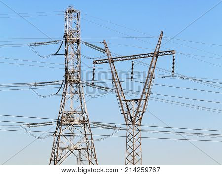 Intermediate anchor poles of power lines with high voltage wires