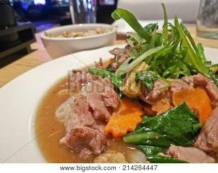 Rad Hna Thai style stir fried flat white noodle with gravy sauce