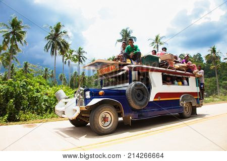 PALAWAN, PHILIPPINES- MARCH 28, 2106: Local people travel with public traditional transportation at Palawan island on March 28, 2016, Philippines.