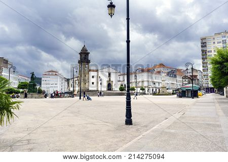 Betanzos, Galicia, Spain. July 30, 2017: Main Square Of The Town With People Walking And A Kiosk Sel