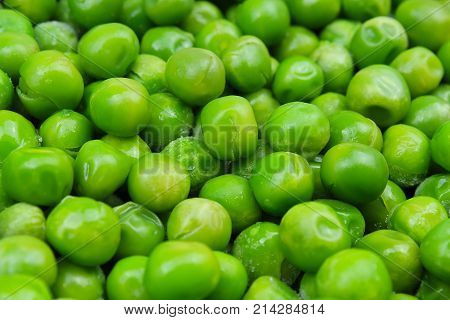 Frozen pea peases texture background. Green pease background pattern. Green peas.