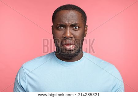 Disappointed Discontent Plump Middle Aged African American Male Curves Lips And Frowns Face Did Some