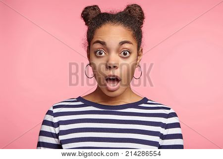 Bugged Eyed African Female Model With Two Hair Buns, Being Stupefied To Realize That Nobody Of Her F