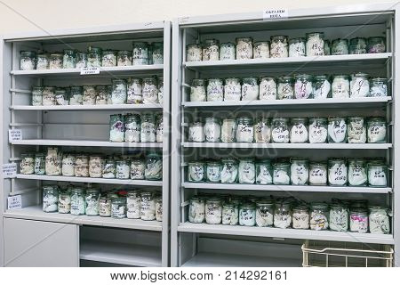MOSCOW RUSSIA - June 24 2009. Glass jars with rags inside - samples of human's sweat and blood. Shelves with material evidences in laboratory of examination human olfactory traces.