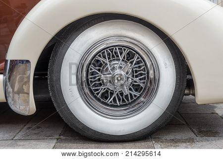 PRAGUE, CZECH REPUBLIC - JUNE 21, 2014: Vintage tire on the Auburn 851 Supercharged speedster. Auburn Speedster was an American car produced in Auburn, Indiana from 1925 through 1937.