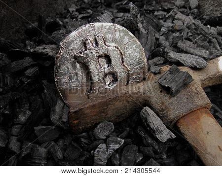 Bitcoin mining. A mine with real hardware. Symbols of block chain technology for crypto currency - metal coin, coal, pickaxe. Background for cryptocurrency and ICO transactions