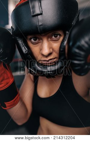 Female Boxer Geared Up For A Bout